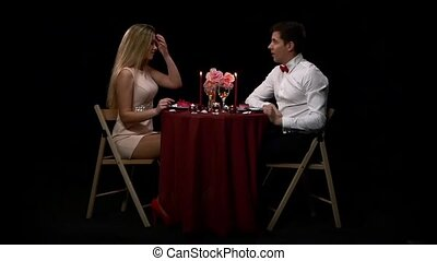 Lovely young couple having romantic dinner. Slow motion