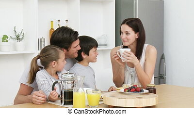 Happy family having breakfast - Happy young family having...