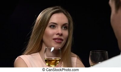 Blonde woman holding glass of wine. Close up, Slow motion -...