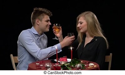 Lovely young couple having romantic dinner in restaurant, Slow motion