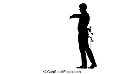 A man hiding a secret rose for his date. Silhouette. Slow motion.
