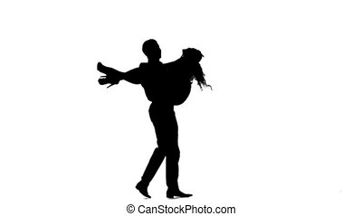 couple man and woman walking hand in hand. Silhouette. Slow motion