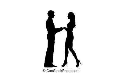 silhouette of two lovers. Isolated on white background. Slow motion