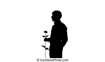 A man hiding a secret rose for his date. Silhouette. Slow motion. Close up