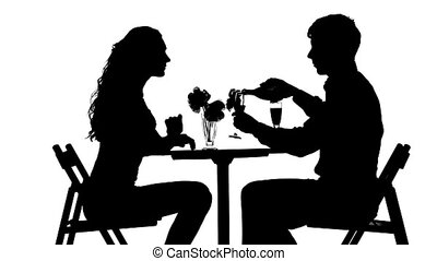 Romantic couple having dinner, red wine silhouette -...