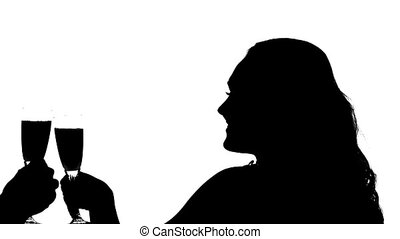 Silhouette of couple clinking glasses of wine, Slow motion,...