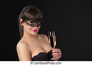 Woman celebrating - Sensual woman wearing black masquerade...