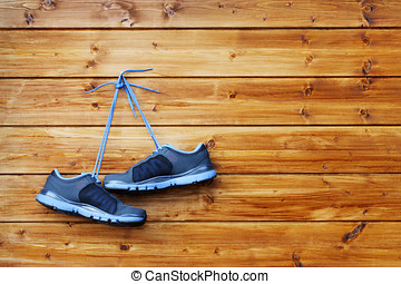 pair of sport shoes hang on a n