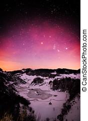 mountain landscape in winter by night - Fundatura Ponorului, Romania