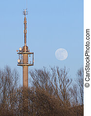 Radio Tower With Moon - Radio tower and moon on a blue sky