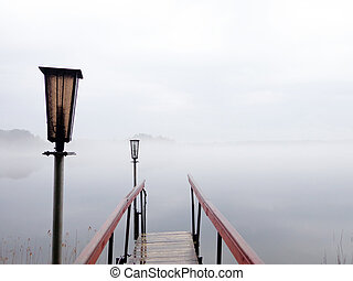 Footbridge - The footbridge to the lake in foggy weather