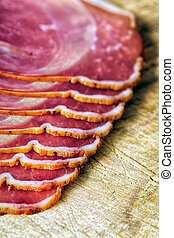 smoked ham with schwarzwald ham and prosciutto - sliced and...