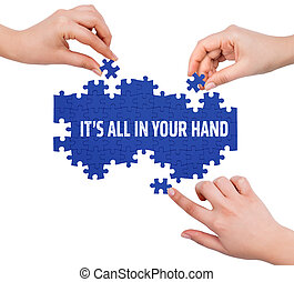 Hands with puzzle making IT'S ALL IN YOUR HAND word  isolated on white