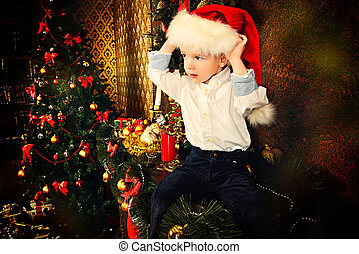 child christmas - Cute little boy celebrating Christmas at...