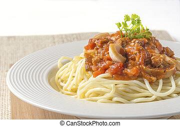 spaghetti - Spaghetti pasta with tomato beef sauce on dish