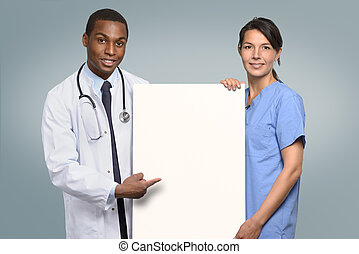 Multiethnic medical team holding a white sign - Multiethnic...