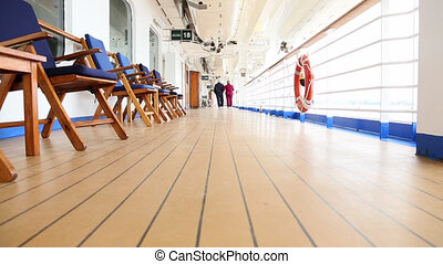 Senior Couple Walking on Ship Deck - Pan of a Loving Senior...