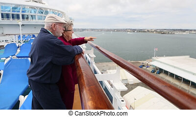 Senior Couple At Railing on Cruise - Loving Senior Couple...