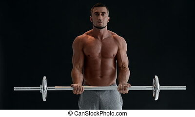 man working out with barbell - Muscular man working out with...