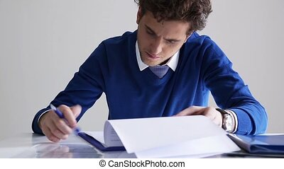 business man signing document - Confident business man...