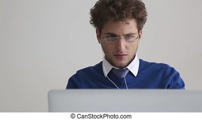 Business man using laptop - Business man listening music and...
