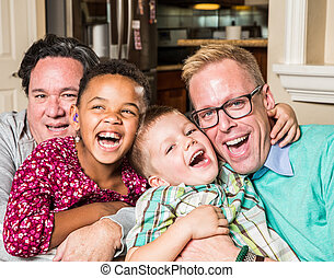 Gay parents with their children - Gay parents and their...