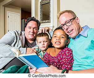 Gay Couple Reads to Children - An attractive gay couple...