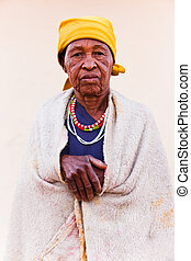 senior African woman - old African woman covered with a...