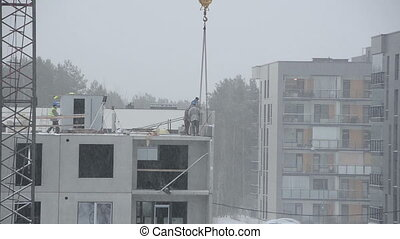 snowstorm construction - Snow falling and construction site...