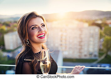 Beautiful woman - Attractive young woman with glass of...