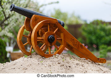 medieval gun on a wooden carriage outdoors