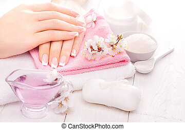 french manicure with essential oils, apricot flowers. spa -...
