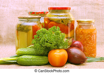 Fresh and tinned vegetables on a sacking