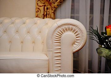 white leather sofa in interior