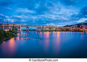 View of bridges over the Williamette River at twilight, in Portland, Oregon.