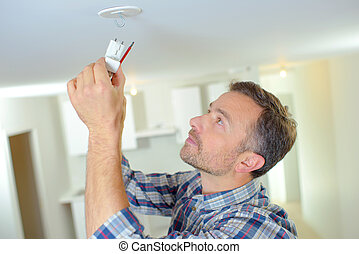 Attaching a smoke alarm to the ceiling