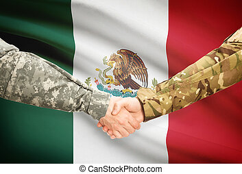 Men in uniform shaking hands with flag on background - Mexico