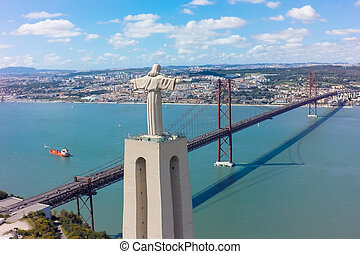 Aerial view Jesus Christ monument watching to Lisbon city in...