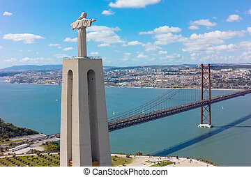 Aerial view Jesus Christ monument watching to Lisbon city in Portugal