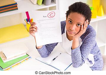 Schoolgirl showing test results