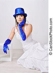 Frightened, surprised the bride in blue gloves and hat.