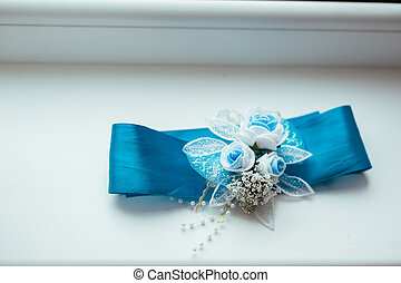 Wedding background with  blue bridal garter on the down.