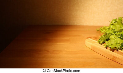 Lettuce on a cutting board - A view of fresh lettuce on a...
