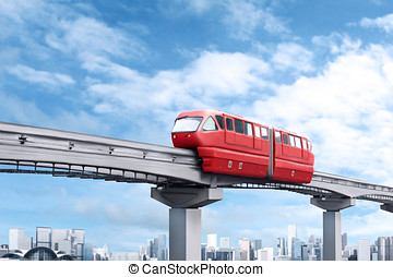Red monorail train against blue sky and modern city in...