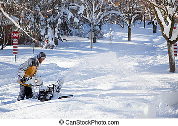 winter snow blowing - A thick layer of snow covers the road...