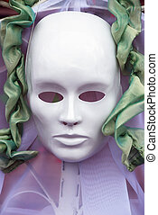 mask - theatrical white mask and green ribbons vertical