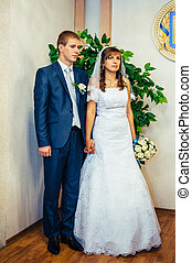 Wedding ceremony Registry office A newly-married couple...