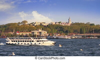 Historical Topkapi Palace and a ferry sailing into...