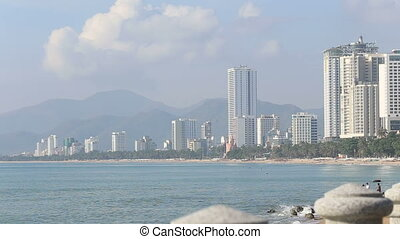 Nha-Trang resort city on seacoast in Vietnam at background...