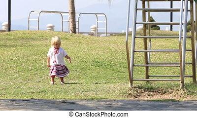blonde girl in Ukrainian  leaves hill to climb slide